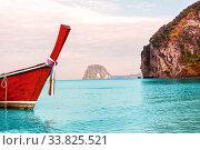Купить «Traditional thai longtail boat detail on andaman sea, tropical island in background.», фото № 33825521, снято 26 мая 2020 г. (c) easy Fotostock / Фотобанк Лори