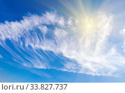 Beautiful cirrus Clouds on a background of blue sky lit by the sun. Стоковое фото, фотограф Акиньшин Владимир / Фотобанк Лори