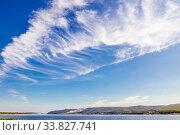 Beautiful cirrus clouds on a blue sky background. Volga river and Zhiguli mountains. Стоковое фото, фотограф Акиньшин Владимир / Фотобанк Лори