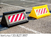 Купить «Road barrier with red and white striped caution pattern», фото № 33827997, снято 26 октября 2019 г. (c) FotograFF / Фотобанк Лори