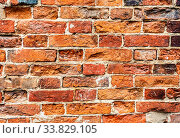 Rough red brick wall as background texture. Стоковое фото, фотограф FotograFF / Фотобанк Лори