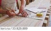 Купить «Caucasian male surfboard maker working in his studio and making a wooden surfboard», видеоролик № 33829889, снято 6 марта 2020 г. (c) Wavebreak Media / Фотобанк Лори