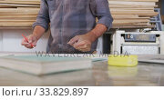 Купить «Caucasian male surfboard makers working in his studio», видеоролик № 33829897, снято 6 марта 2020 г. (c) Wavebreak Media / Фотобанк Лори