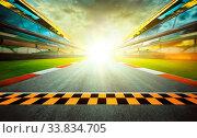 Купить «View of the infinity empty asphalt international race track starting or end line, Motion blurred effect.», фото № 33834705, снято 26 мая 2020 г. (c) easy Fotostock / Фотобанк Лори
