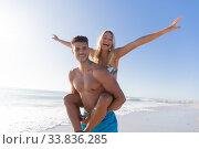 Купить «Caucasian couple enjoying time at the beach», фото № 33836285, снято 25 февраля 2020 г. (c) Wavebreak Media / Фотобанк Лори