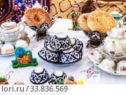 Купить «Ethnic Uzbek ceramics tableware on the table», фото № 33836569, снято 5 октября 2019 г. (c) FotograFF / Фотобанк Лори