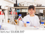 Chinese woman lab technician noting results in test chart. Стоковое фото, фотограф Яков Филимонов / Фотобанк Лори