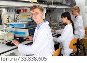 Купить «Student performing experiments in laboratory», фото № 33838605, снято 2 июля 2020 г. (c) Яков Филимонов / Фотобанк Лори