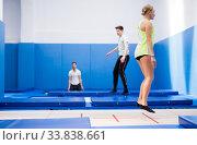 Купить «Female gymnast jumping on trampoline», фото № 33838661, снято 1 февраля 2020 г. (c) Яков Филимонов / Фотобанк Лори