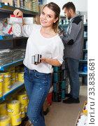 Woman choosing household tools. Стоковое фото, фотограф Яков Филимонов / Фотобанк Лори