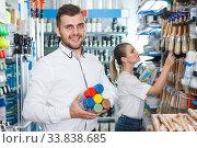 Купить «Nice man and woman choosing paint spray», фото № 33838685, снято 17 мая 2018 г. (c) Яков Филимонов / Фотобанк Лори
