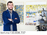 Happy worker demonstrating tools for making keys. Стоковое фото, фотограф Яков Филимонов / Фотобанк Лори