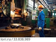 Turner works on large lathe, factory. Стоковое фото, фотограф Tryapitsyn Sergiy / Фотобанк Лори