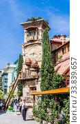 Falling Clock tower of puppet theater Rezo Gabriadze in old town of Tbilisi. Georgia. Редакционное фото, фотограф Николай Коржов / Фотобанк Лори
