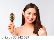 Купить «Portrait of a beautiful young woman comb wonderful hair isolated on white background, asian beauty.», фото № 33842089, снято 5 июня 2020 г. (c) easy Fotostock / Фотобанк Лори