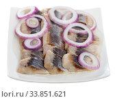 Купить «Marinated herring with sliced onion and parsley», фото № 33851621, снято 27 мая 2020 г. (c) Яков Филимонов / Фотобанк Лори