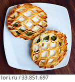 Купить «Pastry stuffed with goat cheese and spinach», фото № 33851697, снято 27 мая 2020 г. (c) Яков Филимонов / Фотобанк Лори