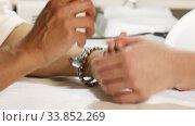 Купить «A manicure master works with the client's nails in a nail salon», видеоролик № 33852269, снято 26 мая 2020 г. (c) Алексей Кузнецов / Фотобанк Лори