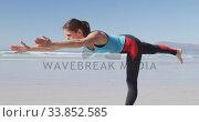 Купить «Caucasian woman doing yoga position on the beach and blue sky background», видеоролик № 33852585, снято 15 октября 2019 г. (c) Wavebreak Media / Фотобанк Лори