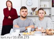 Upset guy and girl after discord with mother. Стоковое фото, фотограф Яков Филимонов / Фотобанк Лори