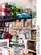 Купить «Barcelona, Spain - January 13, 2020: Assortment of pet feed for sale on shelves in shop», фото № 33858321, снято 13 января 2020 г. (c) Яков Филимонов / Фотобанк Лори