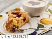 Купить «pie with plums and slice and cup with coffee», фото № 33858781, снято 10 мая 2014 г. (c) Tetiana Chugunova / Фотобанк Лори