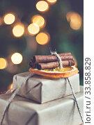 Купить «stack of packed gifts on the background of Christmas lights effect instagram», фото № 33858829, снято 3 ноября 2016 г. (c) Tetiana Chugunova / Фотобанк Лори