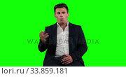 Купить «Animation of a Caucasian man in suit talking in a green background», видеоролик № 33859181, снято 24 октября 2018 г. (c) Wavebreak Media / Фотобанк Лори