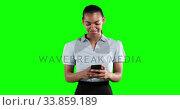 Купить «Animation of a mixed race woman in suit using a phone in a green background», видеоролик № 33859189, снято 24 октября 2018 г. (c) Wavebreak Media / Фотобанк Лори