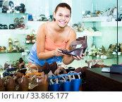 Girl searching for pair of new shoes. Стоковое фото, фотограф Яков Филимонов / Фотобанк Лори