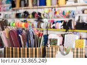 Купить «Colored ribbons on needlework store shelves», фото № 33865249, снято 18 октября 2019 г. (c) Яков Филимонов / Фотобанк Лори