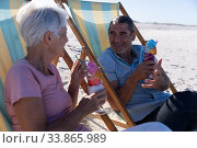 Купить «Senior Caucasian couple sitting on deck chairs at the beach.», фото № 33865989, снято 25 февраля 2020 г. (c) Wavebreak Media / Фотобанк Лори