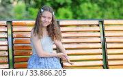 Girl calls the friend and invites him to sit down (2017 год). Редакционное видео, видеограф Бражников Андрей / Фотобанк Лори