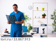 Купить «Young male doctor radiologist working in the clinic», фото № 33867913, снято 15 февраля 2020 г. (c) Elnur / Фотобанк Лори