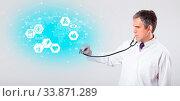 Купить «Middle aged professional doctor with medical concept», фото № 33871289, снято 29 мая 2020 г. (c) easy Fotostock / Фотобанк Лори