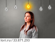 Купить «Young student looking for new idea with lighting bulb concept», фото № 33871293, снято 30 мая 2020 г. (c) easy Fotostock / Фотобанк Лори