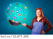 Купить «Young happy person cooking applications in wok», фото № 33871305, снято 30 мая 2020 г. (c) easy Fotostock / Фотобанк Лори