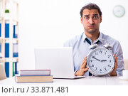Купить «Young male employee working from house», фото № 33871481, снято 30 октября 2019 г. (c) Elnur / Фотобанк Лори