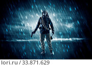 Купить «Terrorist in a stormy space with gas mask on his hand and weapons on his arm», фото № 33871629, снято 2 июня 2020 г. (c) easy Fotostock / Фотобанк Лори
