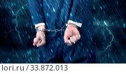 Купить «Stormy bad day concept with close handcuffed elegant man», фото № 33872013, снято 2 июня 2020 г. (c) easy Fotostock / Фотобанк Лори