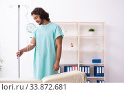 Young male patient in blood transfusion concept. Стоковое фото, фотограф Elnur / Фотобанк Лори