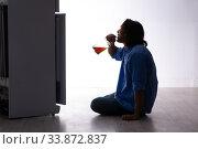 Купить «Young man suffering from alcoholism», фото № 33872837, снято 10 сентября 2019 г. (c) Elnur / Фотобанк Лори