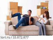 Купить «Young pair and many boxes in divorce settlement concept», фото № 33872877, снято 3 сентября 2019 г. (c) Elnur / Фотобанк Лори