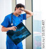 Купить «Young handsome doctor working in the hospital», фото № 33873497, снято 8 августа 2018 г. (c) Elnur / Фотобанк Лори