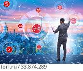 Купить «Concept of smart city with businessman pressing buttons», фото № 33874289, снято 1 июня 2020 г. (c) Elnur / Фотобанк Лори
