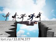 Купить «Businessman acting as a bridge in support concept», фото № 33874377, снято 6 июня 2020 г. (c) Elnur / Фотобанк Лори