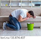 Купить «Sick man suffering at home from infection and bad stomach», фото № 33874437, снято 5 апреля 2017 г. (c) Elnur / Фотобанк Лори