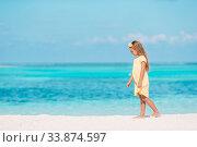Купить «Adorable little girl have fun at tropical beach during vacation», фото № 33874597, снято 31 марта 2015 г. (c) Дмитрий Травников / Фотобанк Лори