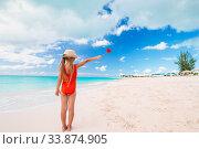 Купить «Adorable little girl have fun at tropical beach during vacation», фото № 33874905, снято 14 апреля 2014 г. (c) Дмитрий Травников / Фотобанк Лори