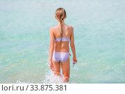 Купить «Adorable little girl have fun at tropical beach during vacation», фото № 33875381, снято 20 февраля 2020 г. (c) Дмитрий Травников / Фотобанк Лори